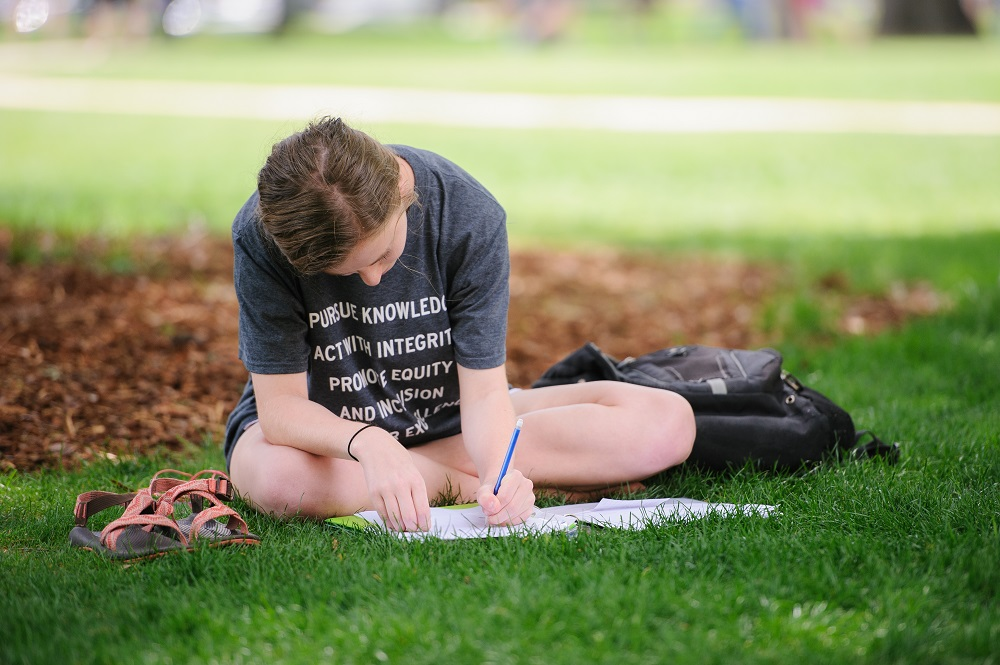 Student studying on the Quad